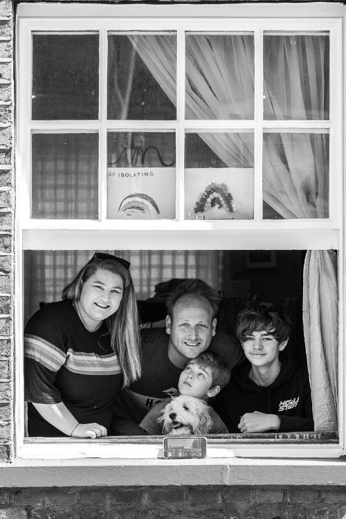 Window family portrait black and white