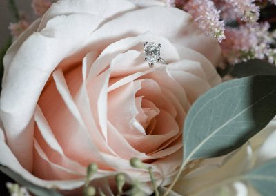 pink-rose-with-engagement-ring-sitting-patels