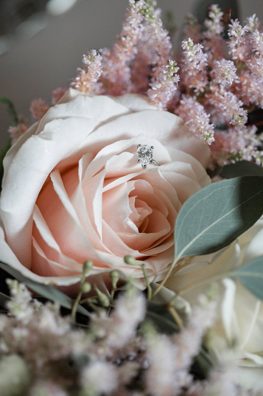 Blush flowers and engagement ring