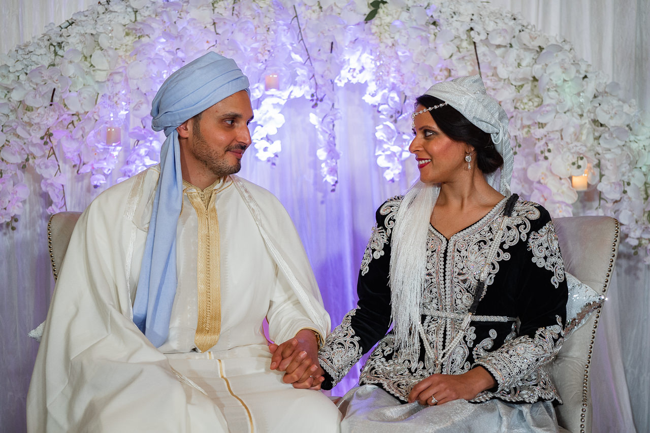 Bride and groom in traditional wedding outfits