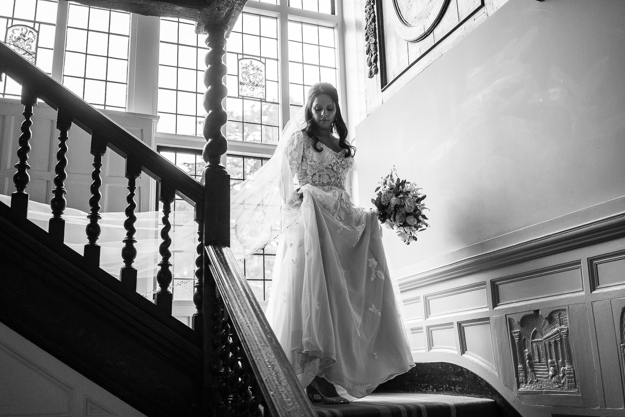 Bride coming downstairs in black and white
