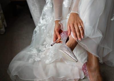 Bride-putting-on-glittery-jimmy-choo-shoes