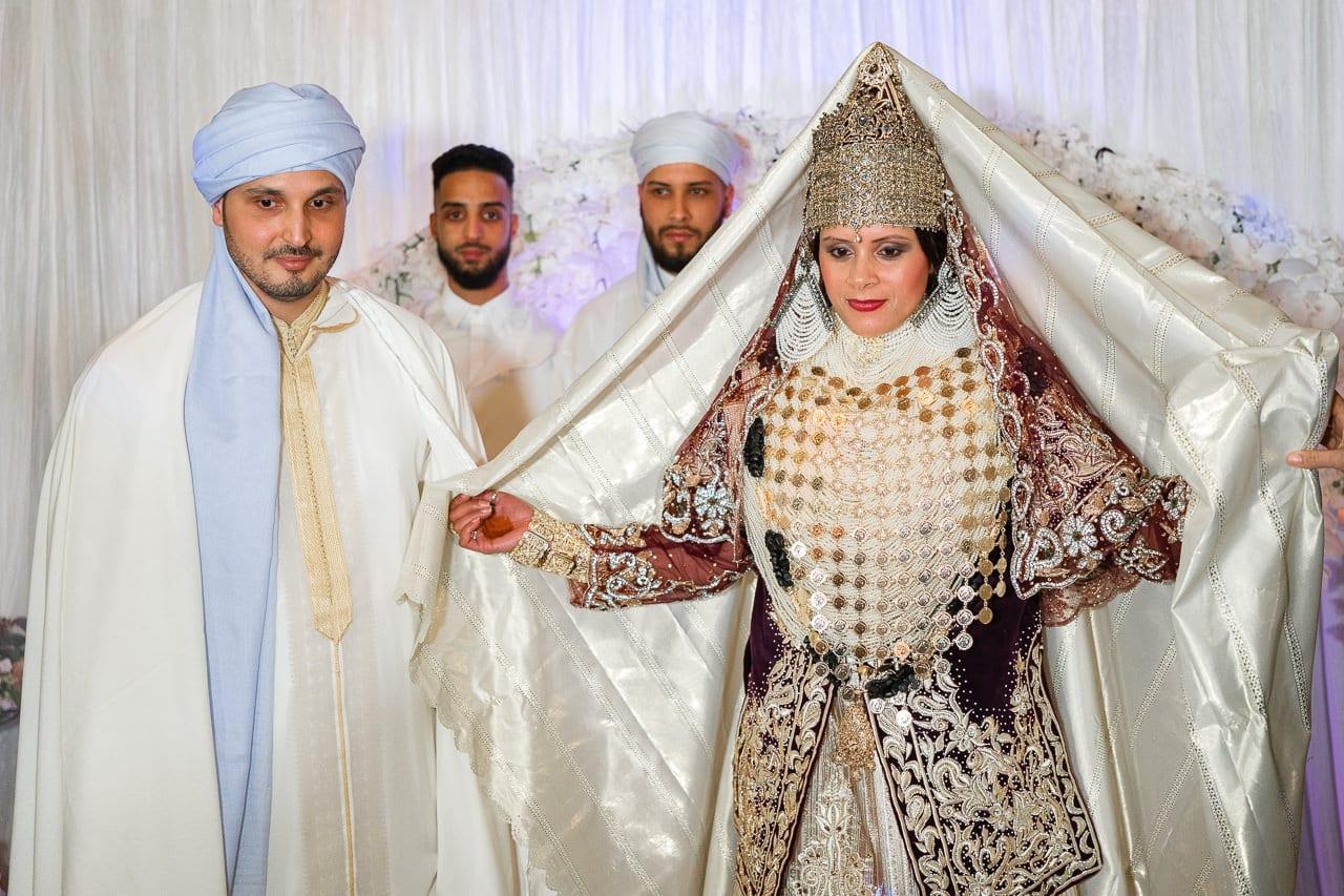 Bride revealing gorgeous traditional wedding dress