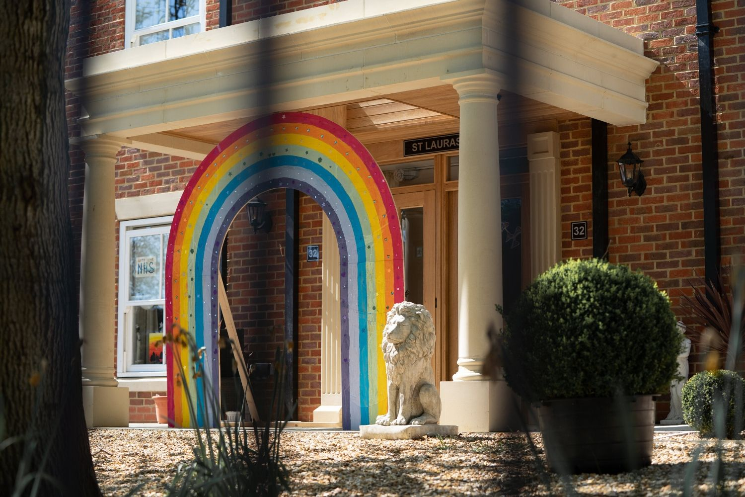 Rainbow in entrance of house