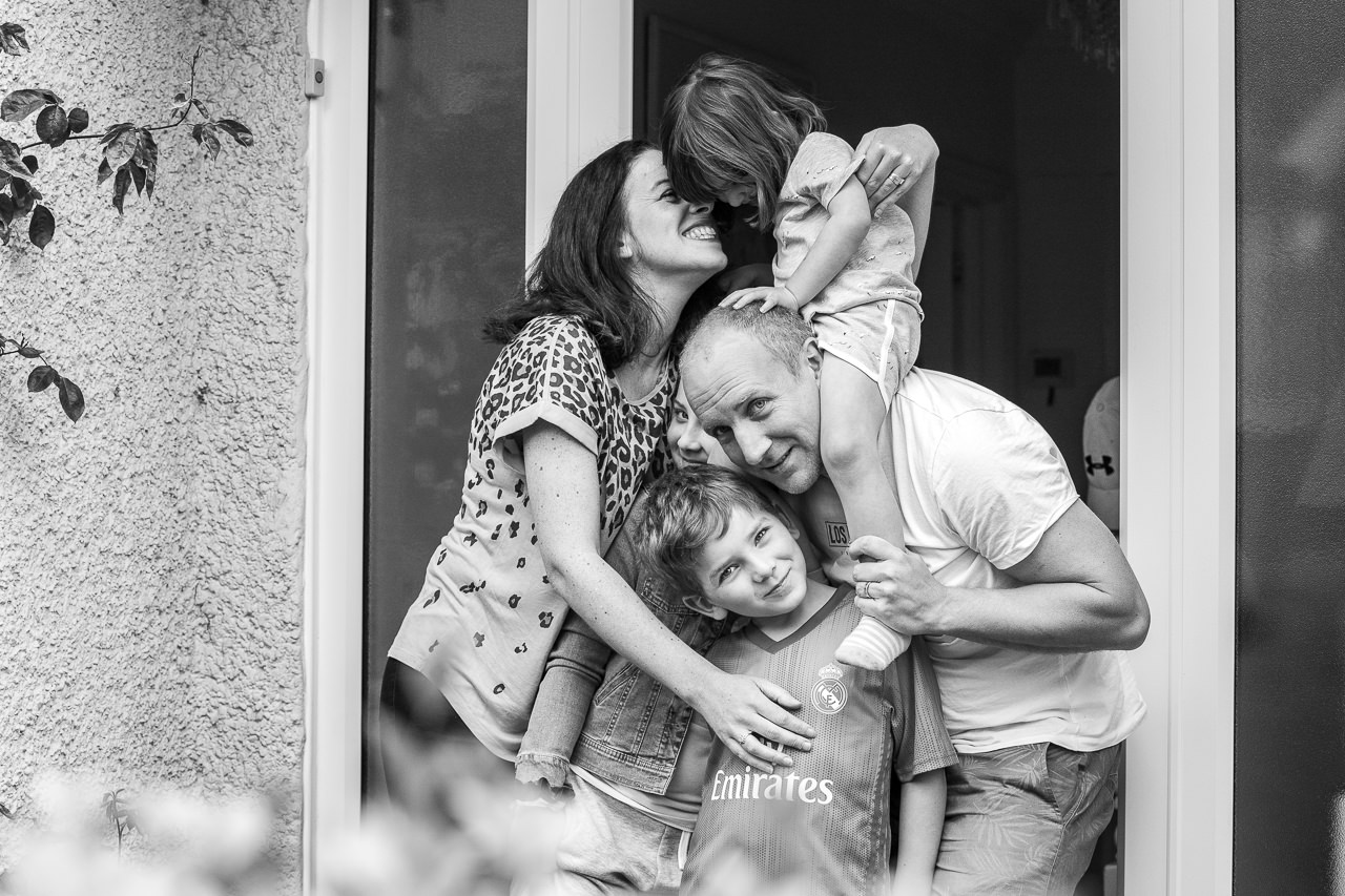 Black and white family doorstep photograph