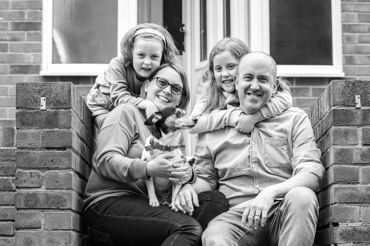 Doorstep family portrait black and white