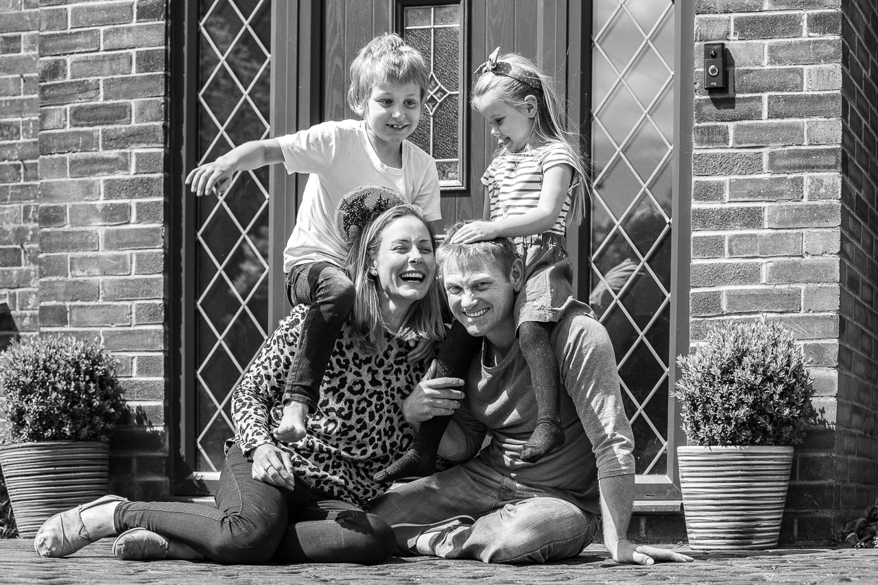 Mum and dad with children doorstep portrait