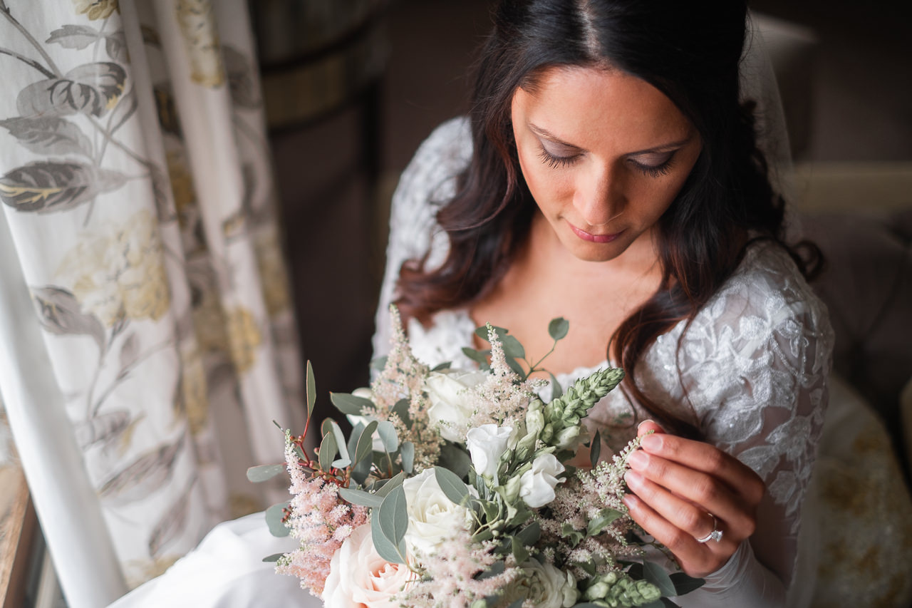 Stunning bride in wedding dress with flowers