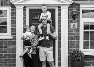 black-and-white-photo-family-portrait-on-doorstep