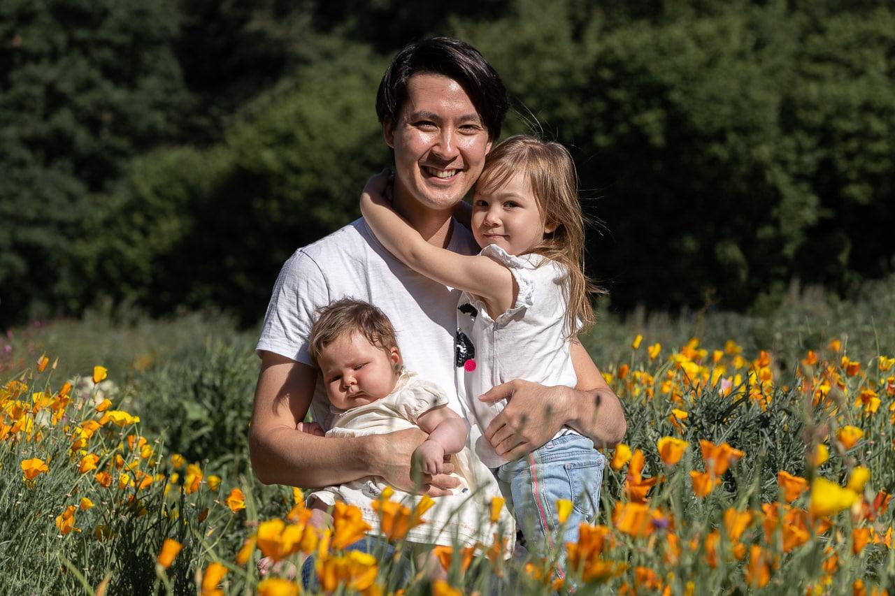 Family of three portrait on doorstep