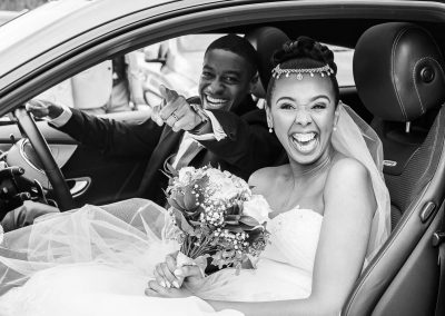 bride-groom-smiling-in-wedding-car