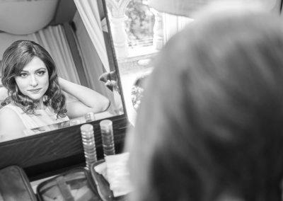 bride-looking-in-mirror-wedding-morning-at-kimpton-fitzroy-london