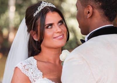 bridelookingatgroomatstokeplacewedding