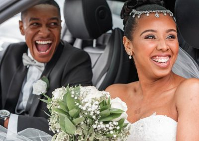 couple-in-car-smiling-at-the-church