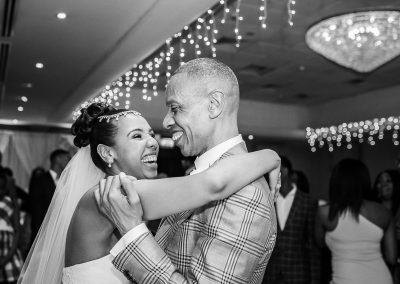 bride-and-father-dancing-and-smiling-together-at-borehamwood-hertfordshire
