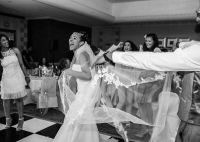 bride-dancing-and-happy-with-friends-and-veil