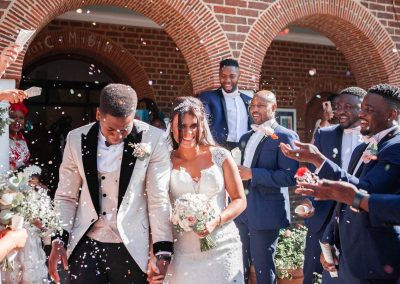 bride-and-groom-walking-through-confetti