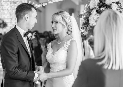 A-bride-and-groom-exchange-vow-stoke-place
