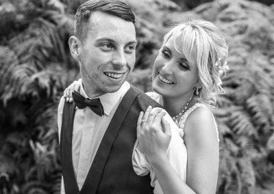 couple-portrait-having-cuddle-black-and-white-photo