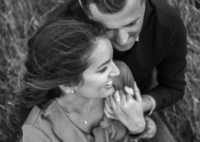 black-and-white-of-engaged-couple-with-wind-sweeped-hair-at-the-grove
