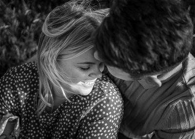 black-and-white-photo-of-engaged-couple-embracing-each-other-at-the-grove-hotel