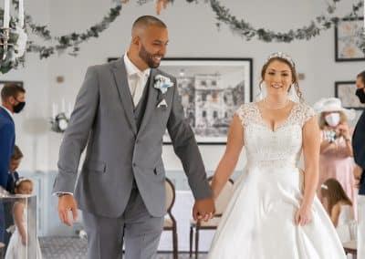 bridal-couple-walking-down-aisle