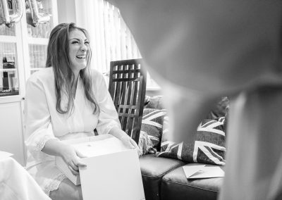 bride-opening-surprise-box-black-and-white
