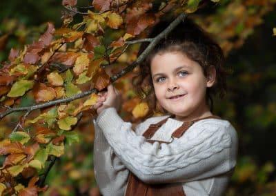child-portrait-in-autumn-coloured-wood-sarratt-woods