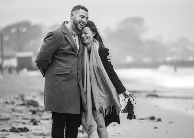 couple-engagement-walking-on-beach-at Swanage