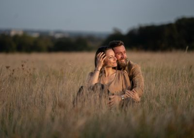 couple-sitting-in-long-grass-at-the-grove-hotel-hertfordshire