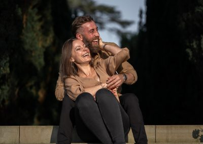 engaged-couple-sitting-on-stairs-in-the-gardens-of-the-grove-hotel