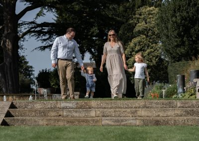 family-portrait-walking-through-gardens-at-the-grove