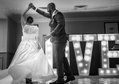 groom-and-bride-dancing-first-dance-in-black-and-white