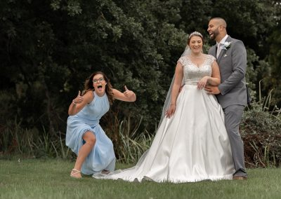 maid-of-honor-making-faces-behind-couple-laughing