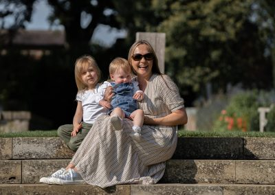 mother-and-daughters-sitting-steps-at-the-grove-hertfordshire