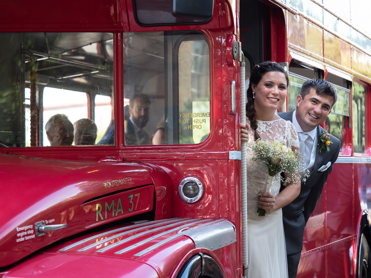 Bride-and-groom-on-red-double-decker-bus