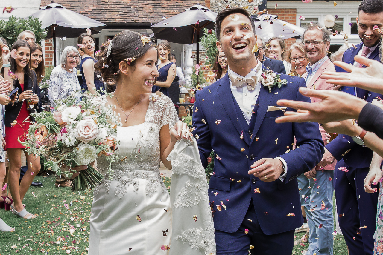 bride-and-groom-wlaking-through-confetti-line-at-the-grange
