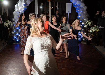 bride-throwing-her-green-white-bouquet-to-bridesmaids