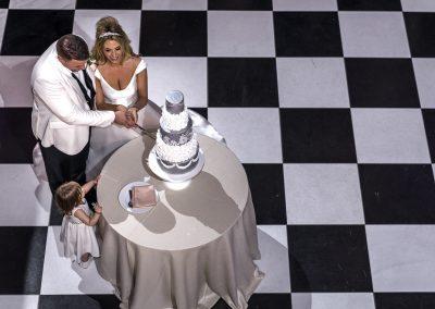 bride-and-groom-cutting-cake-on-dance-floor