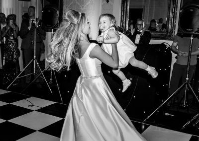 bride-baby-girl-in-a-twirl-on-dance-floor-at-hedsor-house