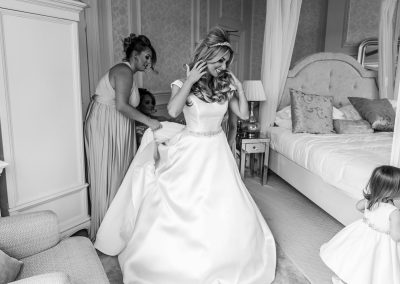 bride-getting-ready-with-her-little-girl-black-white-photo