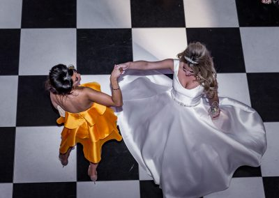 bridesmaid-friend-and-bride-dancing-on-floor-at-hedsor-house