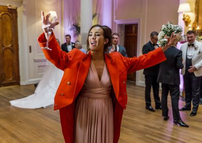 bridesmaid-in-red-jacket-at-hedsor-house