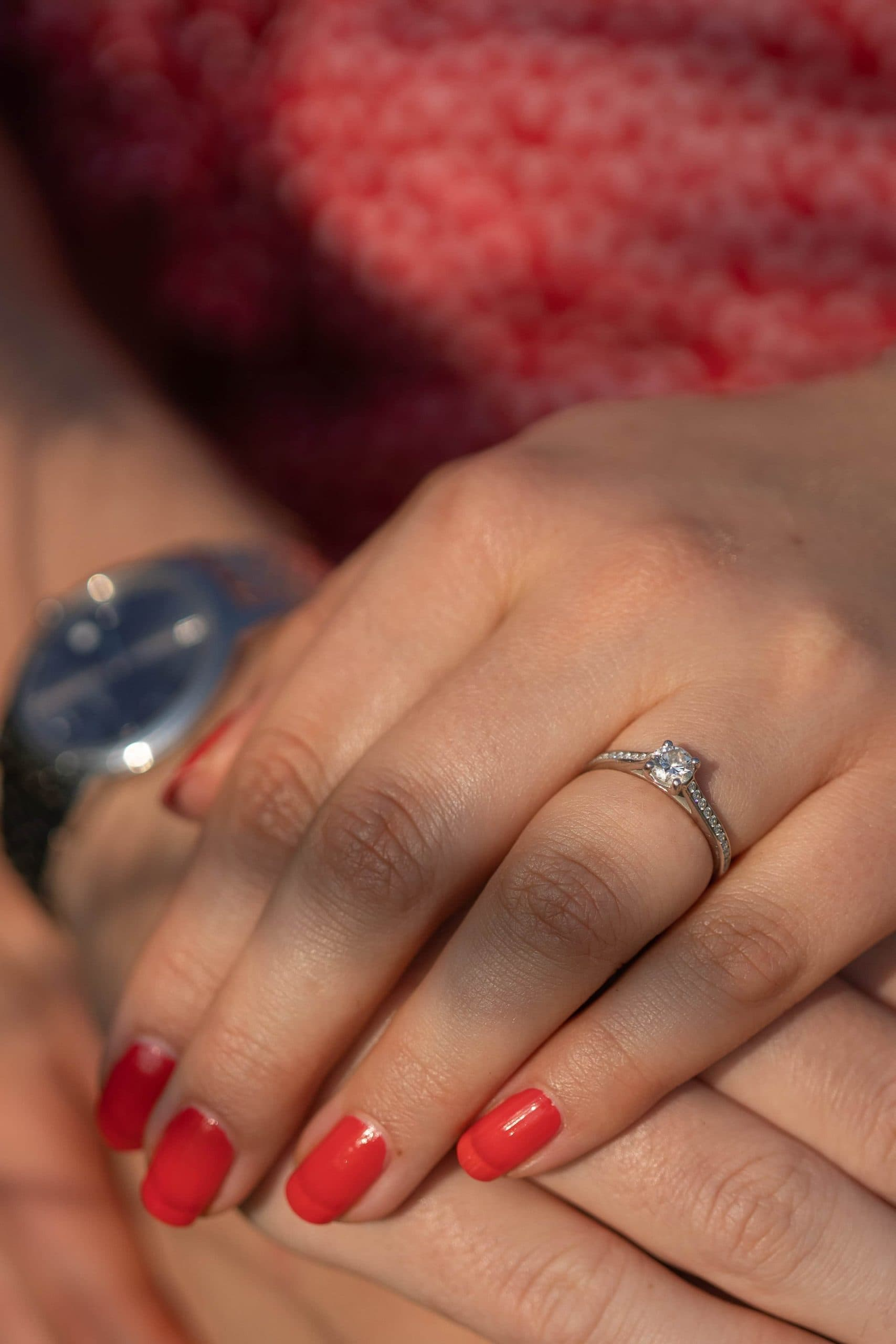 couples-holding-hands-with-engagement-ring