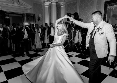 groom-and-bride-first-dance-black-and-white