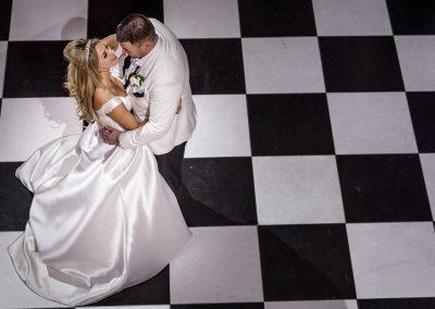 groom-twirling-bride-on-dance-floor-at-hedsor-house