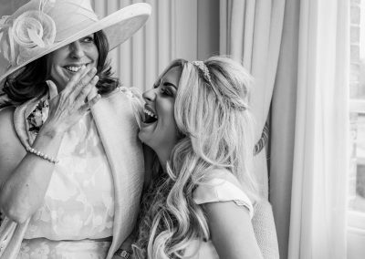 mother-and-daughter-laughing-together-in-black-and-white